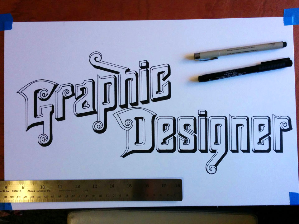 Photo of decorative hand-lettering design of the words 'Graphic Designer.'