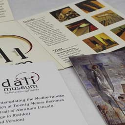 Direct mail concept for Dali Museum. Mailer is unfolded to reveal photos, artwork, and a die-cut pocket with inserts.